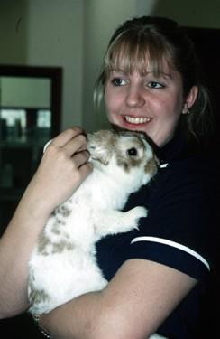 woman holding pet rabbit